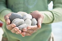 Man holding rocks