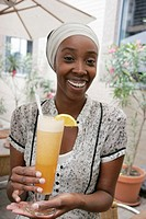 Canada, Montreal, Rue McGill, Vieux Montreal, Boris Bistro, restaurant, Black female hostess, holds tropical drink,