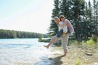 Playful couple wading in a river