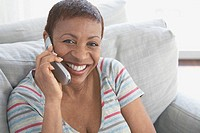 Happy woman using a cell phone