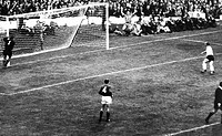 Beckenbauer shoots, World Cup, Anfield, 25 July 1966 Lev Yashin of the Soviet Union clutches the post as Franz Beckenbauer's shot rebounds across the ...