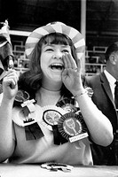 Female football supporter, World Cup, Wembley, July 1966 18-year-old Linda Caves from Bedford is an England supporter but also wears rosettes from oth...