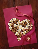 Lemon hearts and dark marzipan hearts with pistachios