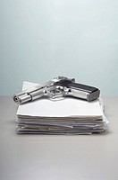 Handgun on stack of documents