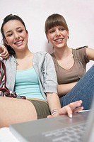 Girls using laptop computer