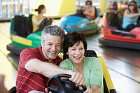Husband and wife riding in a bumper car