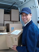 Male delivery person in cap with van and boxes (thumbnail)