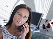 Businesswoman on telephone in modern office