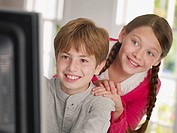 Young boy and girl at a computer