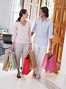 Couple entering home with shopping bags