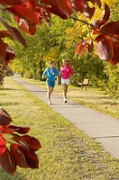 Two women running together in park