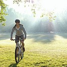 Woman riding mountain bike in park