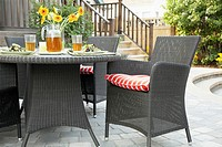 Outdoor table and armchairs