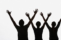Three people with arms up