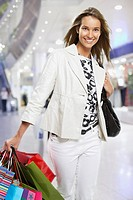 Woman walking with shopping bags (thumbnail)