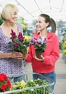 Woman and girl shopping for plants