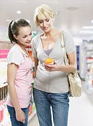 Woman and girl shopping in store