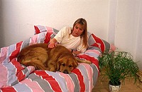 dog and woman in bed