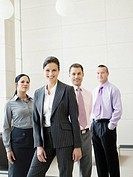 Four businesspeople standing in an office