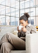 Woman drinking mug of coffee