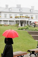 Canada, Quebec City, Parc de la Chute_Montmoracy, Manoir Montmoracy, waterfall park, woman, red umbrella, villa manor,