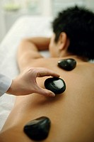 Man getting stone massage