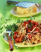 Wholemeal ribbon pasta with tomato & caper sauce and thyme