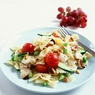 Pasta salad with chicken breast, tomatoes, cashew & pine nuts