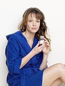 Woman in blue bathrobe with pills (thumbnail)