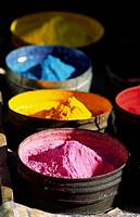 Coloured powder for dying textile. Pisac, Peru