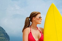 Hawaii, Oahu, Girl on beach with yellow surfboard