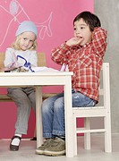 Girl and boy sitting at the table