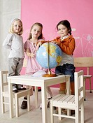 Three girls with a globe (thumbnail)