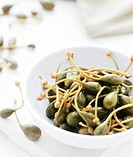 Capers in a bowl  Capers are the unopened flower buds of the caper plant Capparis spinosa  They are pickled and used in cooking to garnish meat and ve...