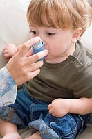 Childhood asthma  Parent helping their son use an inhaler during an asthma attack  He is one and a half years old  Asthma is a condition in which the ...