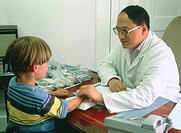 Pulse measurement  View of a Chinese herbal medical practitioner taking a 5 year-old boy´s pulse  The doctor is assessing the boy´s pulse by gently sq...
