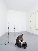 Reverberation chamber  Researcher inside an reverberation chamber, a room used for testing acoustic equipment  The room is specifically designed to ma...