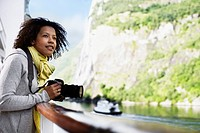 Woman on Fjord Cruise Holding a Camera