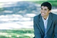 Businessman in park, smiling