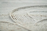 Pattern traced into sand, full frame, extreme close-up
