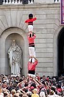 ´Castellers´ building human towers, a Catalan tradition. Mercè festivals. Plaça de Sant Jaume. Barcelona, Spain.