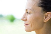 Woman smiling, profile
