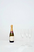 Champagne bottle and glasses on table