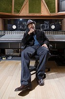 Music producer smiling in studio (thumbnail)