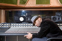 Music producer listening to music in studio