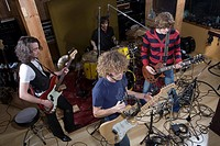 Band playing music in recording studio