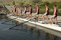 Rowing team posing on dock