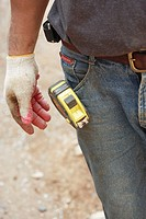 Construction worker detail of measuring tape on pants pocket