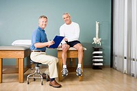 Physical therapist and patient in office
