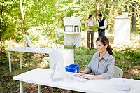 Businesswoman at desk in woods